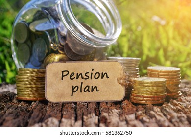 Business Concept - Paper tag written with PENSION PLAN inscription. Coins stack, jar and nature background.