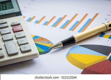 Business concept, Pen and calculator on graph background