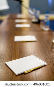 Business concept  with pens and paper on wooden table in conference room