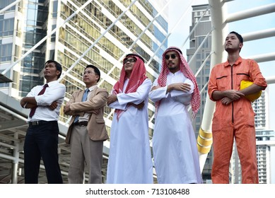 business concept : business people and Arab men standing together with modern city background