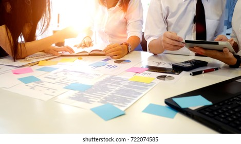 Business concept : People helping one of their colleague to finish new business plan.Brainstorming Business Working Report Concept