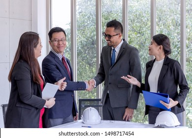 business concept; Business people shaking hands after finished a meeting.