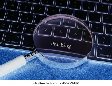 Business concept: Phishing on computer keyboard background
