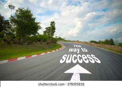 business concept picture of way to successful and road arrow direction racetrack straight to the mountain with the clear sky.