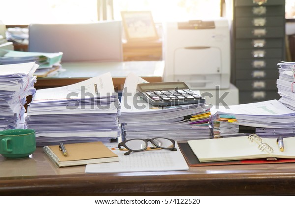 Business Concept, Pile of unfinished documents on office desk, Stack of business paper