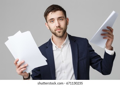Business Concept - Portrait Handsome Business man serious working with annual report. isolated White Background. Copy space.