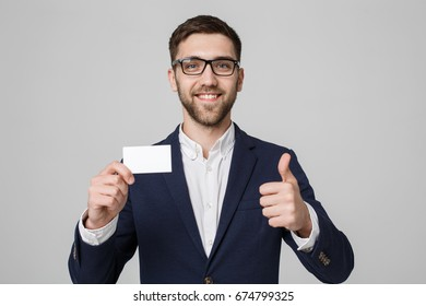Business Concept - Portrait Handsome Business man showing name card with smiling confident face and thumb up. White Background.Copy Space.