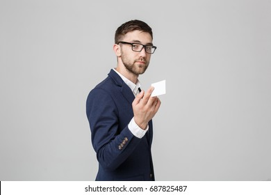 Business Concept - Portrait Handsome Business man showing name card with smiling confident face. White Background.Copy Space.