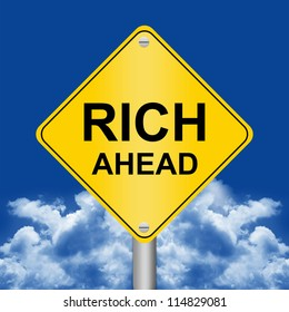 Business Concept Present By Yellow Rhombus Rich Ahead Road Sign Against A Blue Sky Background
