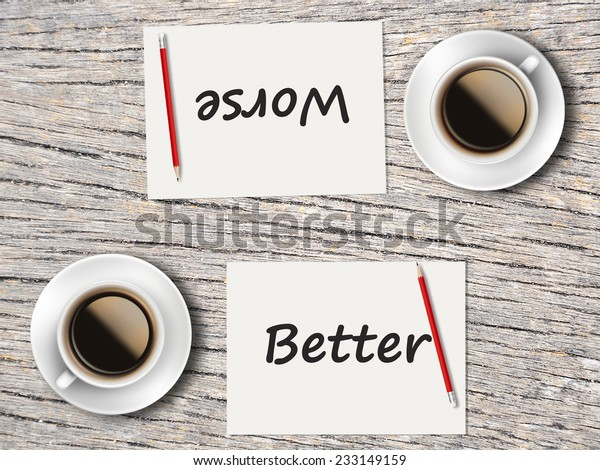 Business Concept (Rotatable) : Two Coffee, Papers And Pencils On The Table  Facing Each Other Head To Head To Compare Between Better And Worse.