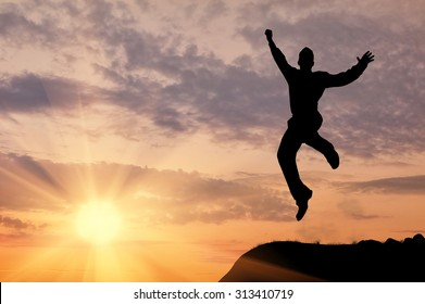 Business concept. Silhouette of a man jumping in the sunset
