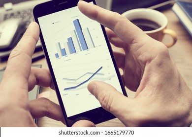 business concept - smarthphone in the hand