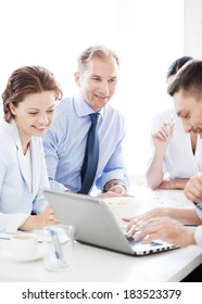 business concept - smiling businessman with team on meeting in office