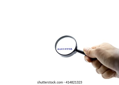 Business concept success letters under the magnifier in white background