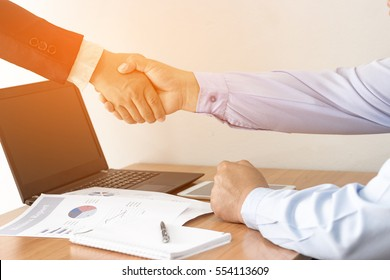 Business concept, Successful two businessman handshaking after good deal in office.