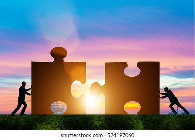 Business concept of teamwork with jigsaw puzzle