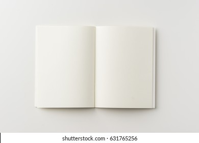 Business concept - Top view of blank notebook on white background desk for mockup