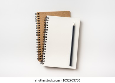 Business concept - Top view collection of two kraft spiral notebook and black pencil isolated on background for mockup
