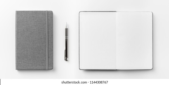 Business concept - Top view collection of  grey notebook front, back pen, and white open page isolated on background for mockup