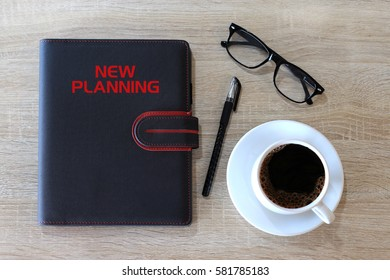 Business concept - Top view cover notebook writing New Planning