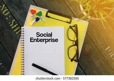 Business concept - Top view notebook writing Social Enterprise