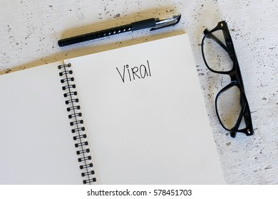 Business concept - Top view notebook writing Viral