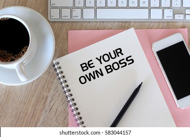 Business concept - Top view notebook writing Be Your Own Boss