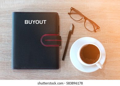 Business concept - Top view notebook cover writing BUYOUT