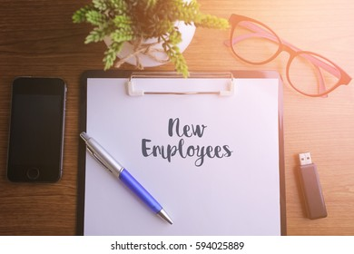 Business concept - Top view notebook writing New Employees