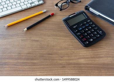 business concept. top view of office desk workspace with calculator, pencil, keyboard and glasses on white table background