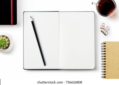 Business concept - Top view of stationery like open notebook, pencil...etc for mockup design isolated on white desktop background