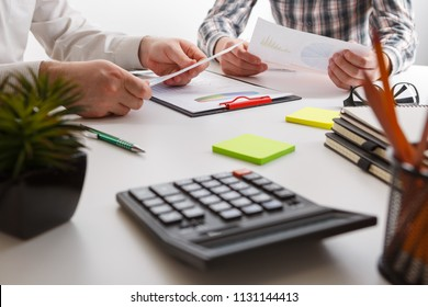 Business concept. Two business mans working and meeting with chart at office on his desk. Business people discussion. Teamwork togetherness concept