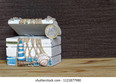 Business concept Vintage decorative chest with euro coins on wooden table.