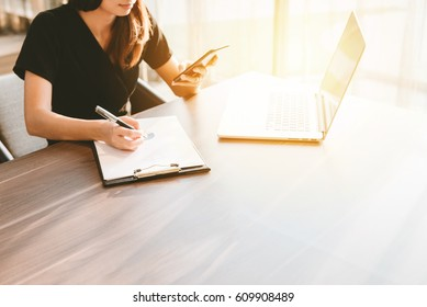 business concept, Business woman working overload in office space at sunset time