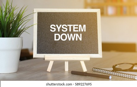 BUSINESS CONCEPT WORDS ON BLACKBOARD : SYSTEM DOWN