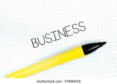 BUSINESS concept write text on notebook