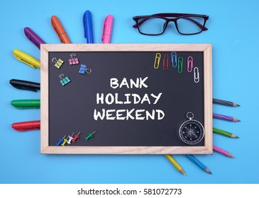 Business Concept writing BANK HOLIDAY WEEKEND on Blackboard