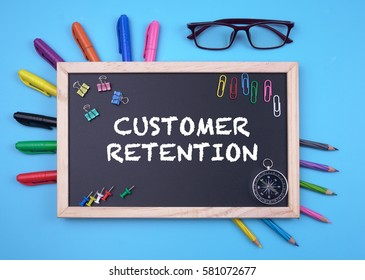 Business Concept writing Customer Retention on Blackboard
