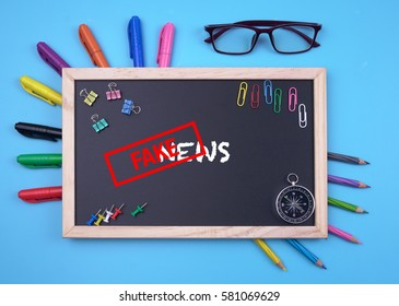 Business Concept writing Fake News on Blackboard