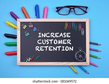 Business Concept writing INCREASE CUSTOMER RETENTION on Blackboard