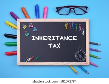 Business Concept writing inheritance tax on Blackboard
