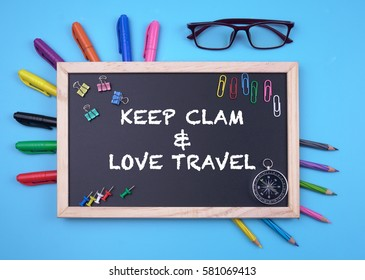 Business Concept writing KEEP CLAM & LOVE TRAVEL on Blackboard