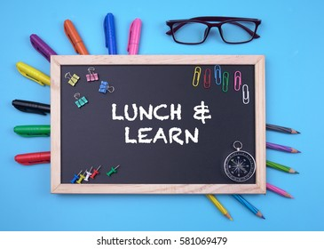 Business Concept writing LUNCH & LEARN on Blackboard