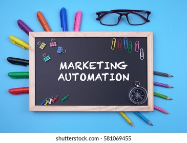 Business Concept writing MARKETING AUTOMATION on Blackboard
