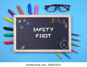 Business Concept writing SAFETY FIRST on Blackboard
