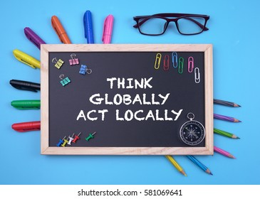 Business Concept writing THINK GLOBALLY ACT LOCALLY on Blackboard