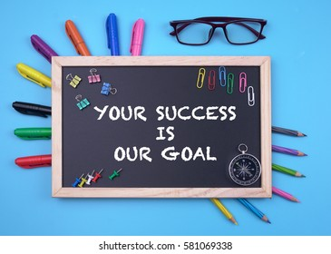 Business Concept writing YOUR SUCCESS IS OUR GOAL on Blackboard
