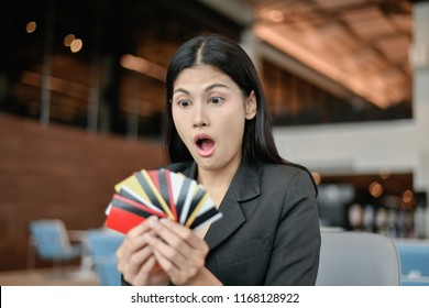 Business concept. Young businesswoman is using a credit card. Young business girls are choosing the best credit card.