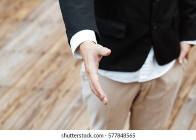Business Concept - Young Business man give hand for shaking.