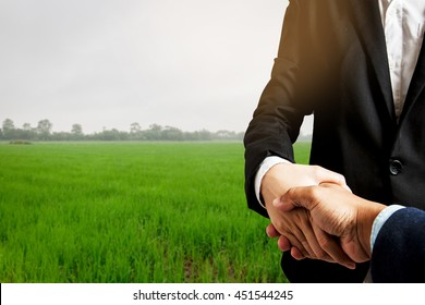 Business concept.Business handshake land purchase